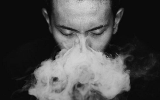 vaping a dry herb vaporizer
